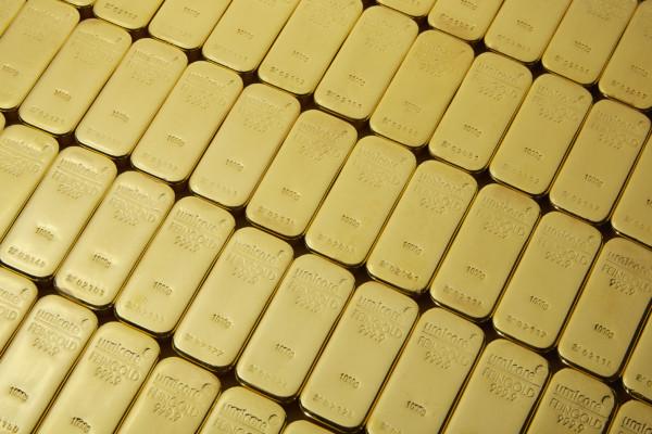 kultaharkot levynä gold bars in a row